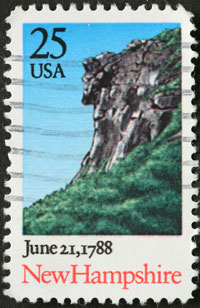 Stamp with New Hampshire's Old Man of the Mountain rock formation which is no longer there.