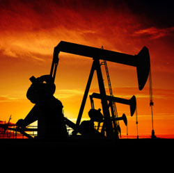 Oil pumpjacks in silhouette at sunset, New Mexico